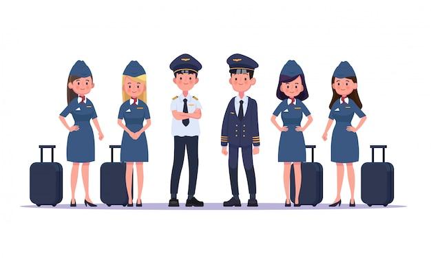 パイロットと客室乗務員、飛行機のホステスのグループ。フラットなデザインの人々のキャラクター。 Premiumベクター