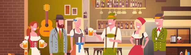 Group of people drink beer in bar oktoberfest party celebration man and woman wearing traditional clothes fest concept Premium Vector
