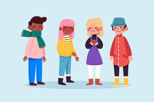 Gruppo di persone che indossano abiti invernali accoglienti Vettore gratuito