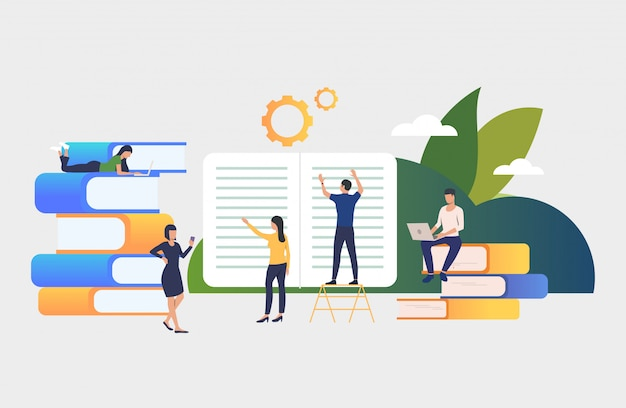 group of people working with books