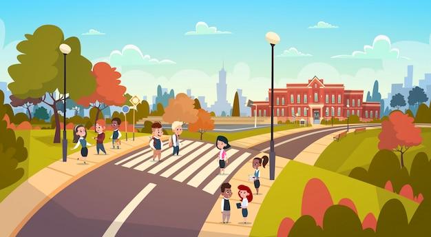 Group of pupils walking on crosswalk mix race students go to school crossing street Premium Vector