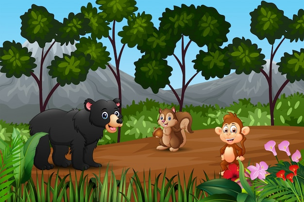 Group of wild animals gathering on the fringe of forest Premium Vector