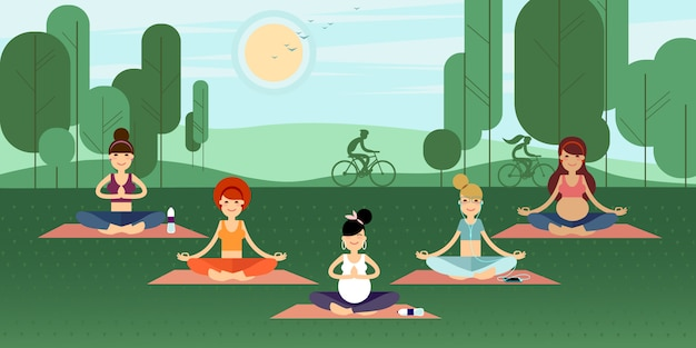 Group of yoga girls in a summer park. Premium Vector