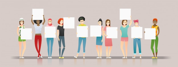 Group of young women holding empty boards Premium Vector