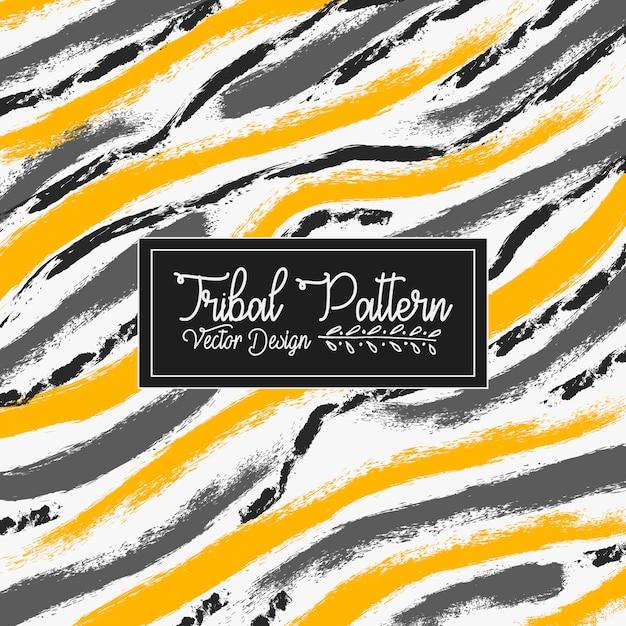 Grunge brush textured tribal pattern vector background Free Vector