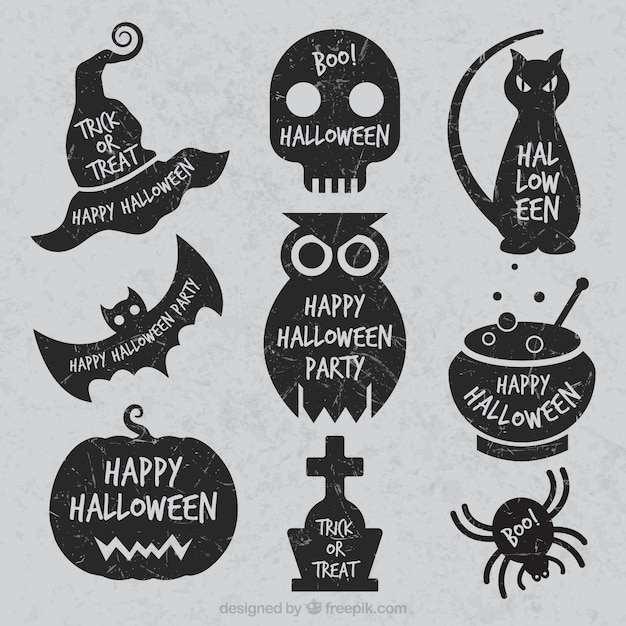 Grunge halloween labels Free Vector