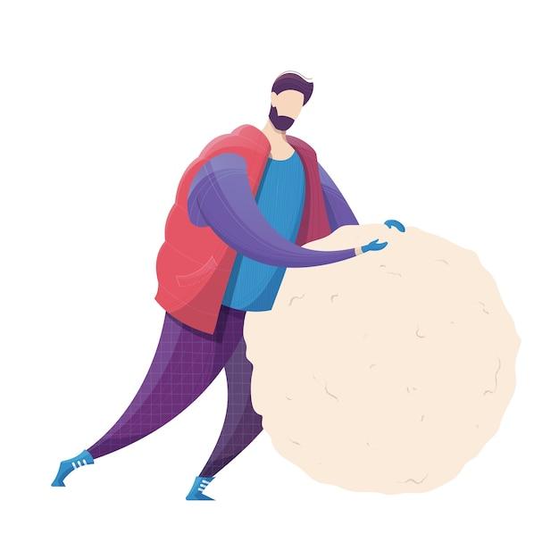 男は雪だるまの冬の野外活動のために大きな雪玉を作ります Premiumベクター
