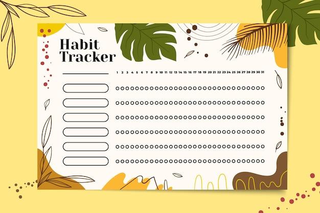 Habit tracker with tropical background Premium Vector