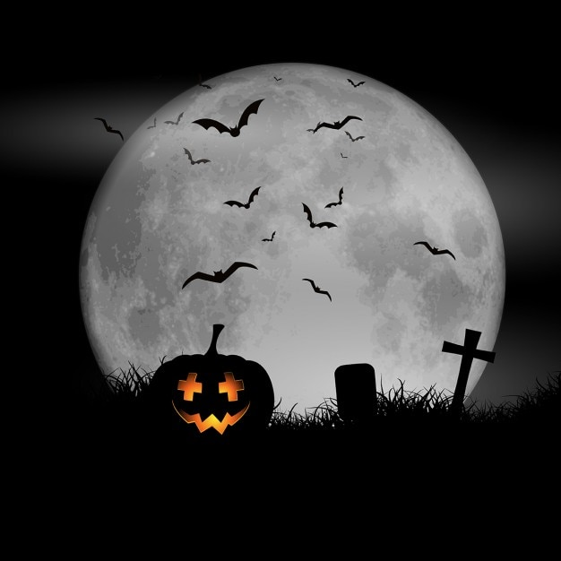 Halloween background with pumpkin against a moonlit sky Free Vector