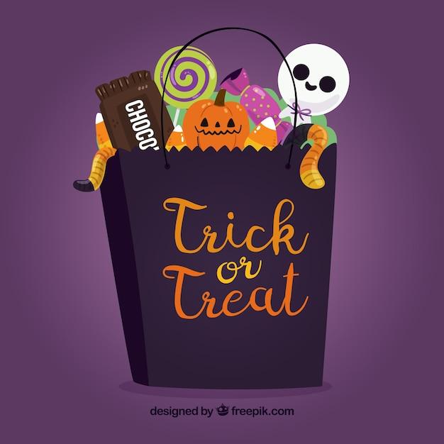 Halloween bag full of candies Free Vector