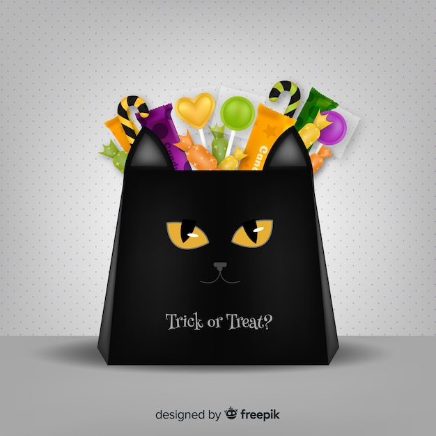 Halloween candy bag background concept Free Vector