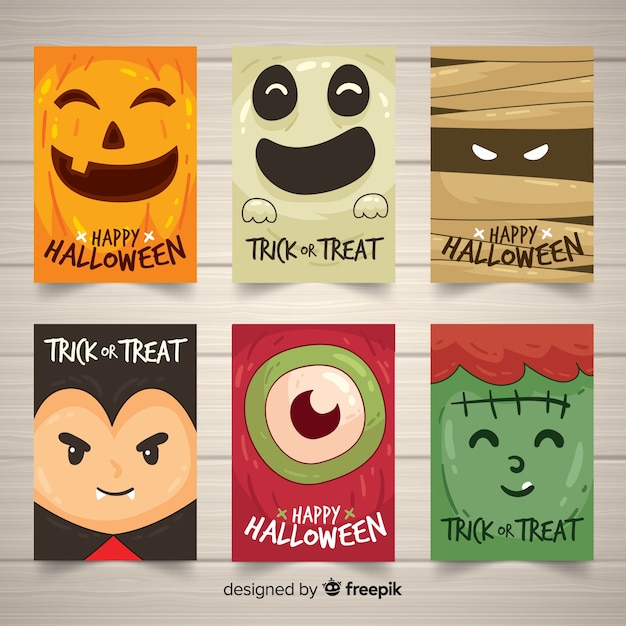 Halloween card collection with funny monsters Free Vector