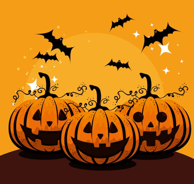 Halloween card with pumpkins and bats flying Free Vector