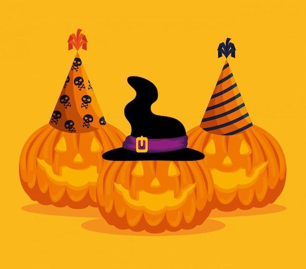 Halloween card with pumpkins and hats Free Vector