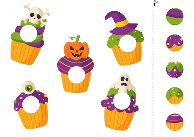 子供のためのハロウィーンのカップケーキカットアンドグルーゲーム。 Premiumベクター