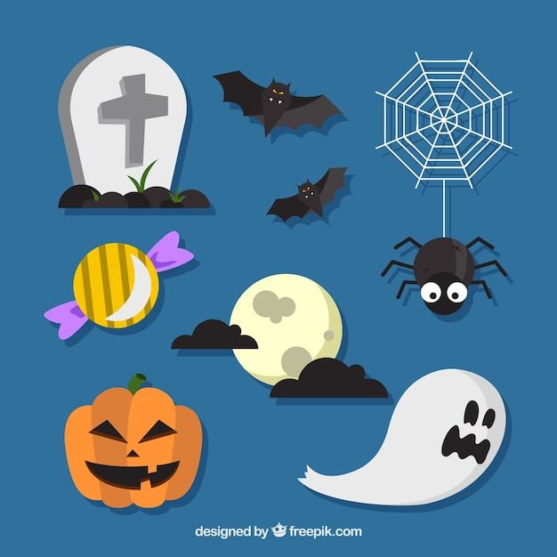 Halloween elements on a blue background Free Vector