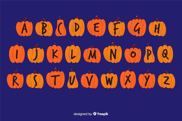 Halloween pumpkin alphabet concept Free Vector