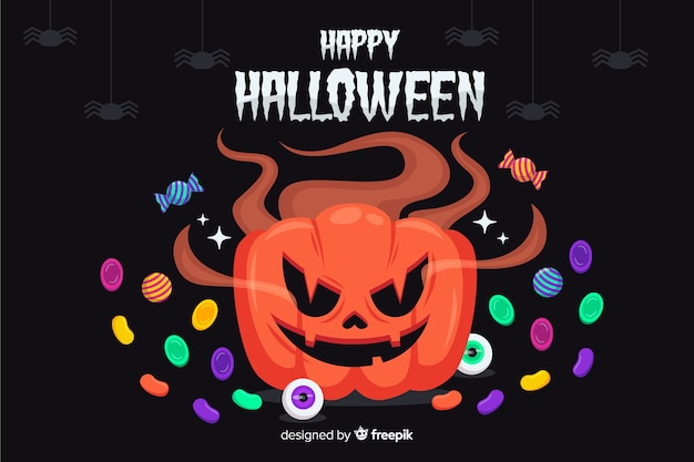 Halloween pumpkin surrounded by candies background Free Vector