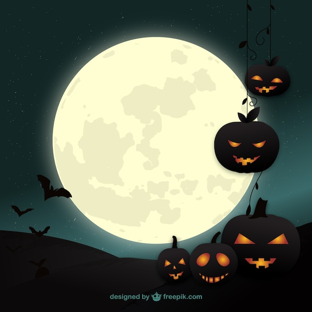 Halloween pumpkins background Free Vector