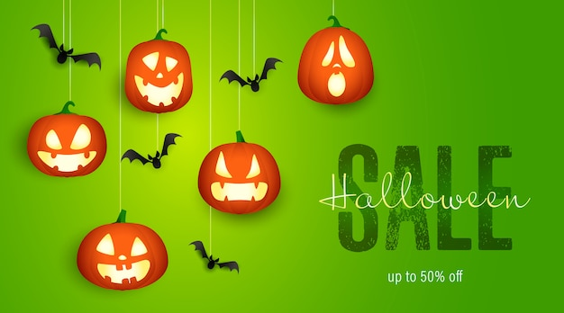 Halloween sale banner with bats and pumpkin lanterns Free Vector