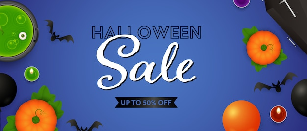 Halloween sale lettering, pumpkins, potion and candles Free Vector