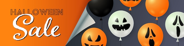 Halloween sale lettering with pumpkin and ghost balloons Free Vector