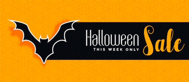 Halloween sale yellow banner with bat silhouette Free Vector