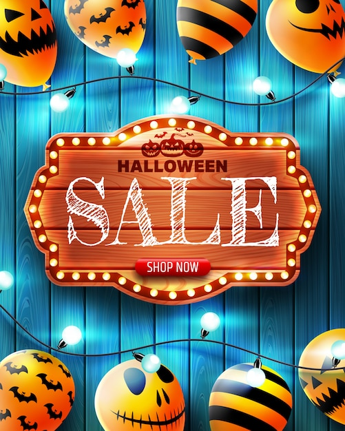 Halloween vertical sale banner with scary balloons Premium Vector