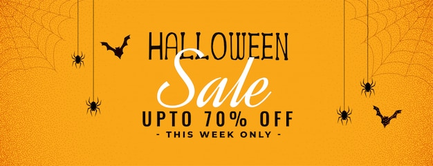 Halloween yellow sale banner with spider and cobweb Free Vector