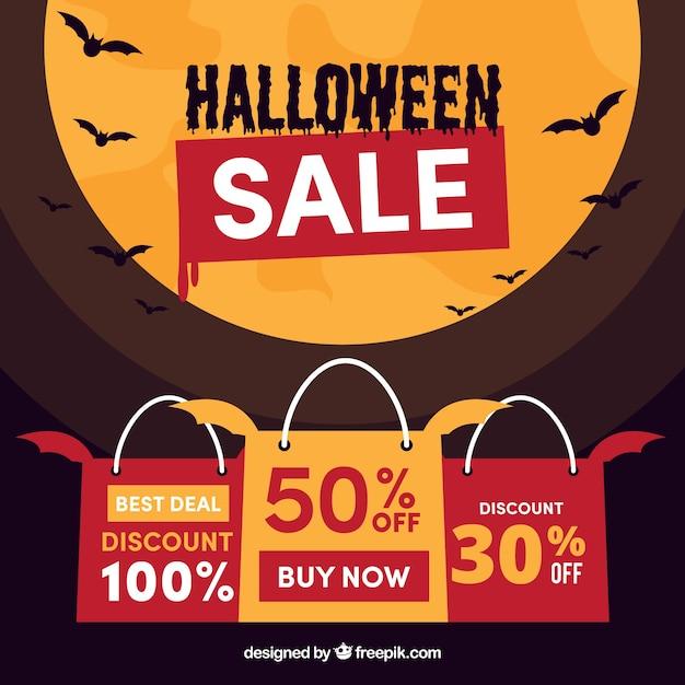 ハロウィンの販売の背景と月のデザイン 無料ベクター