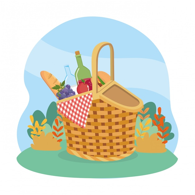 Hamper with bread and wine bottle with grapes and hamburger Free Vector