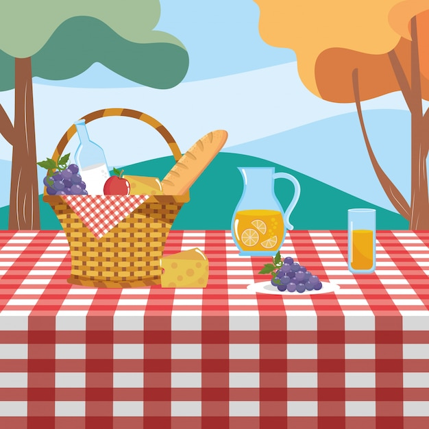 Hamper with grape and milk bottle with orange juice Free Vector
