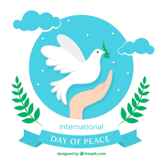 Hand background with dove of peace in the sky Free Vector