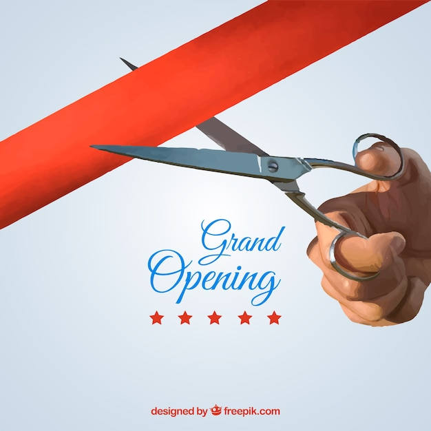 Hand background with scissors cutting a red ribbon