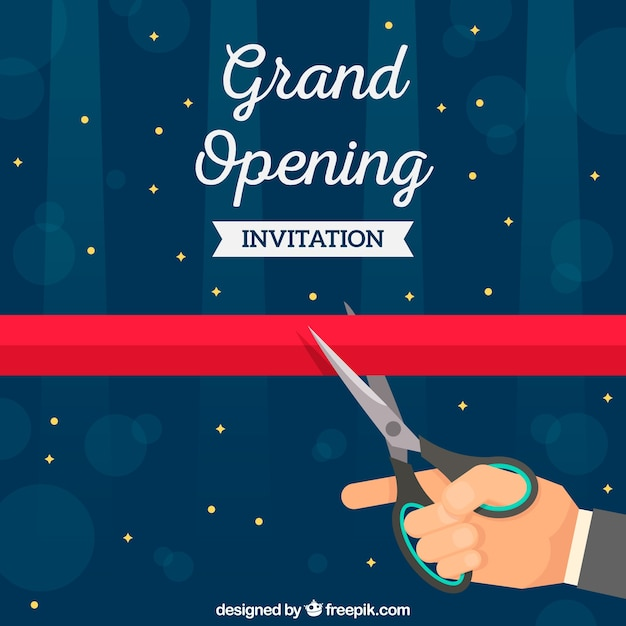 Hand cutting ribbon with scissors