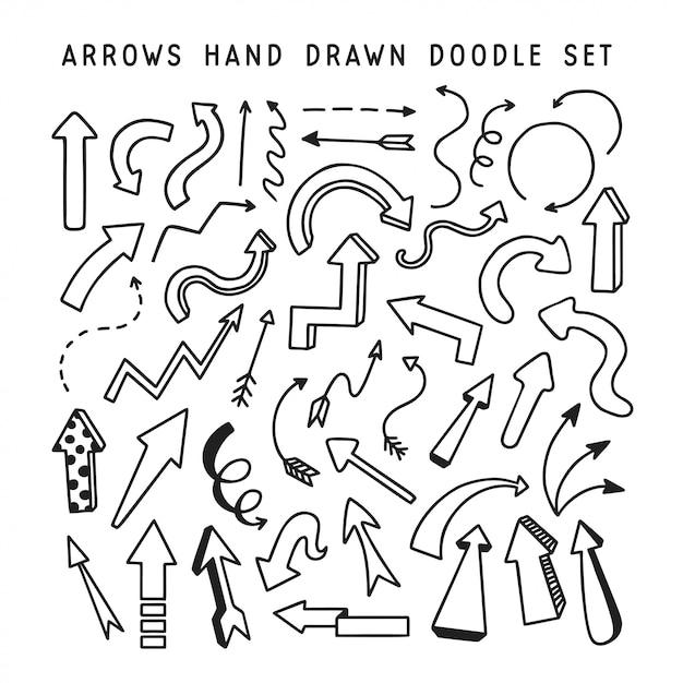 Hand drawn arrows doodle set Premium Vector
