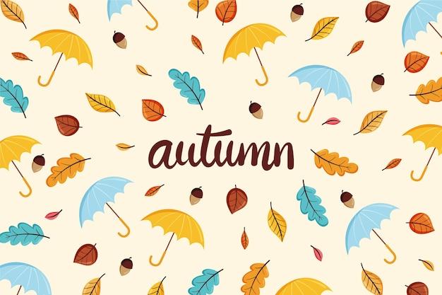 手描きの秋の背景の葉とパラソル 無料ベクター