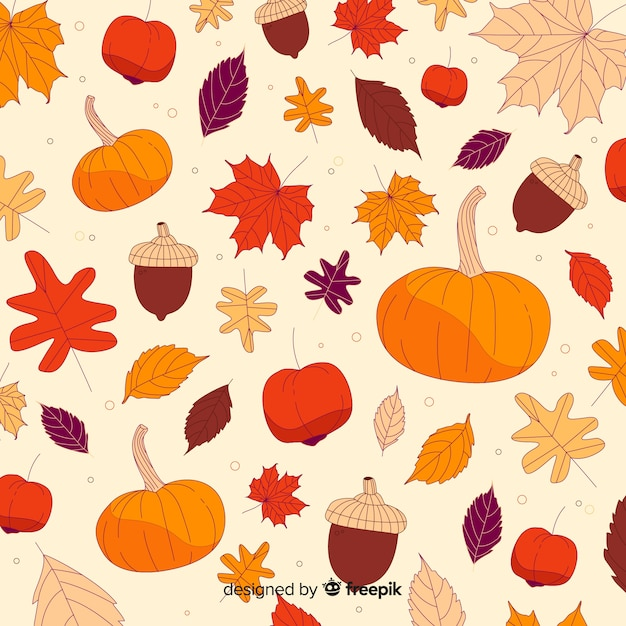 Hand drawn autumn forest leaves background Free Vector