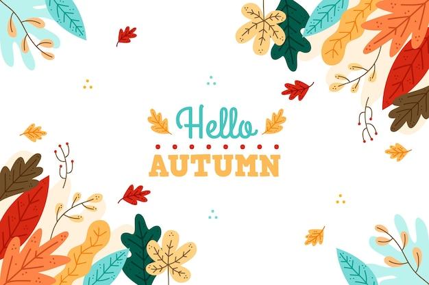 Foglie di autunno disegnati a mano sullo sfondo Vettore gratuito