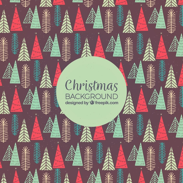 Hand drawn background with christmas trees pattern Free Vector