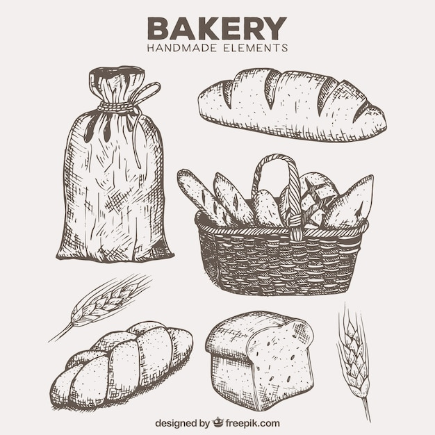 Hand drawn bakery products with basket and flour Free Vector