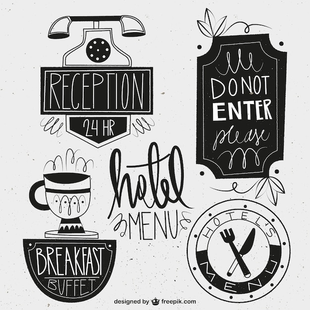 Hand drawn black hotel labels in a vintage style Free Vector