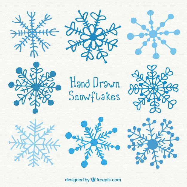 Hand drawn blue snowflakes vector premium download