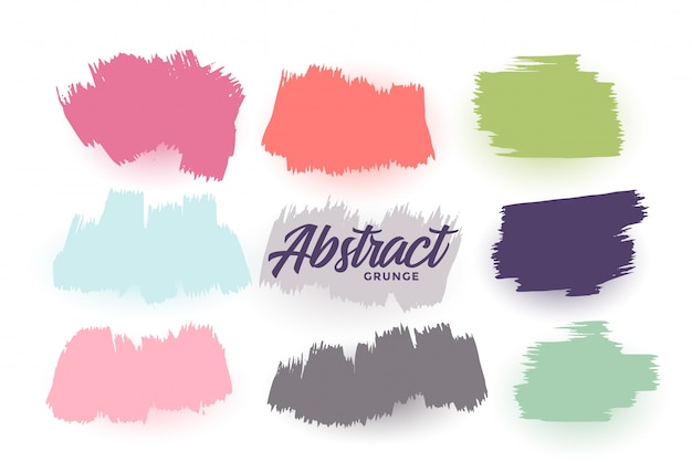 Hand drawn brush strokes set in different colors Free Vector