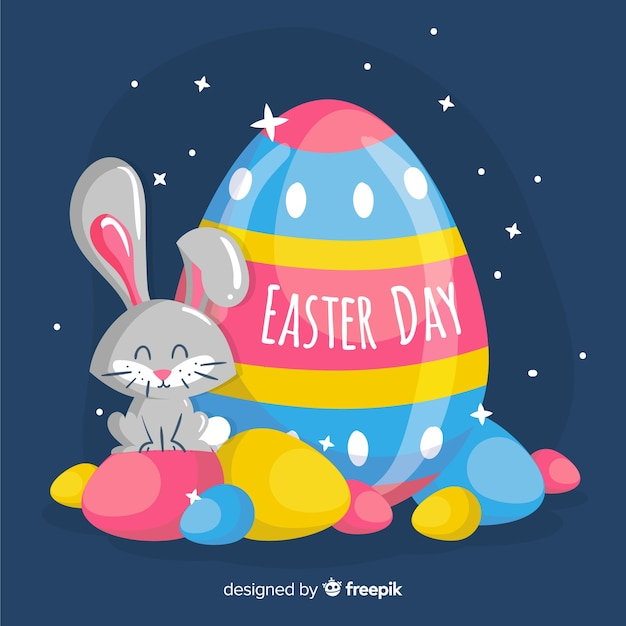 Hand drawn bunny with eggs at night easter day background Free Vector