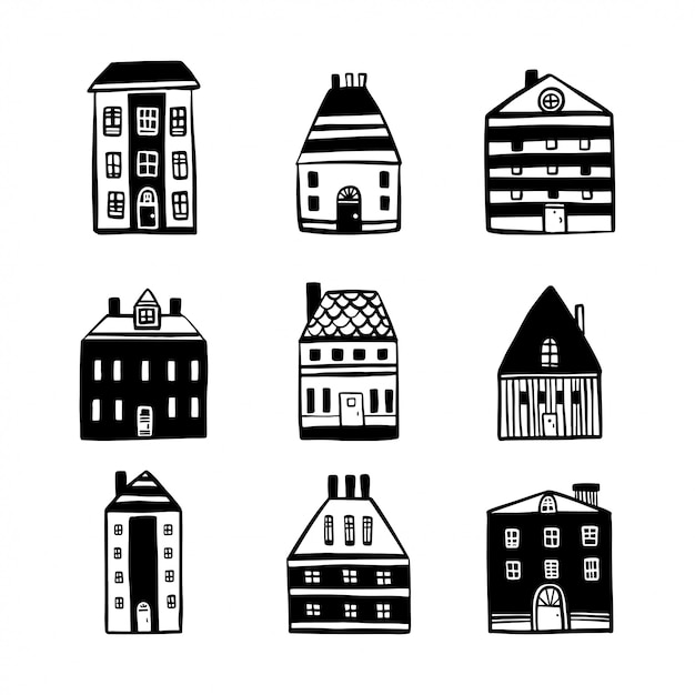 Hand drawn cartoon houses set. Premium Vector