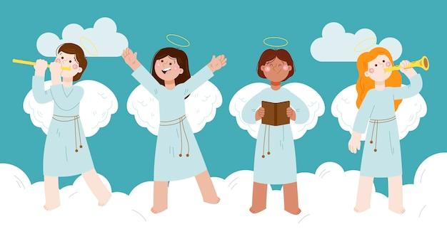 Collezione di angeli di natale disegnati a mano Vettore gratuito