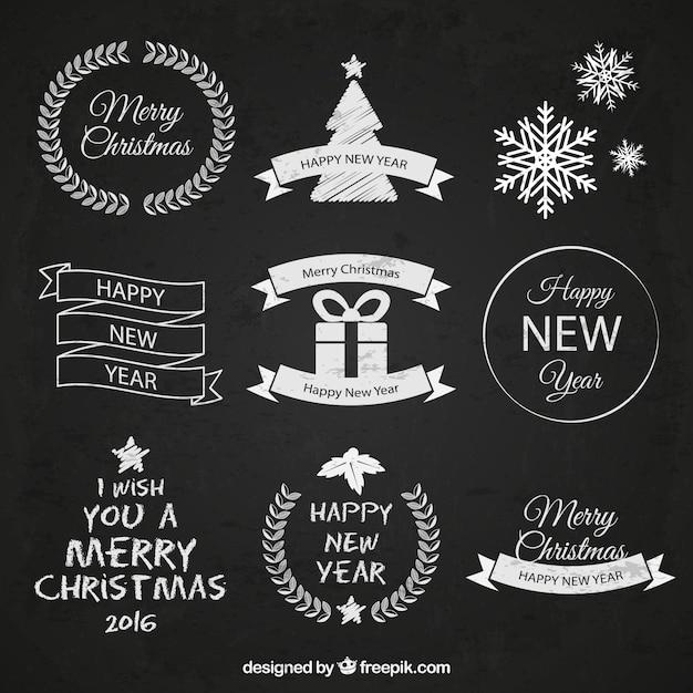 Hand drawn christmas badges on blackboard