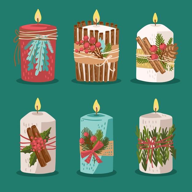 Collezione di candele di natale disegnate a mano Vettore gratuito