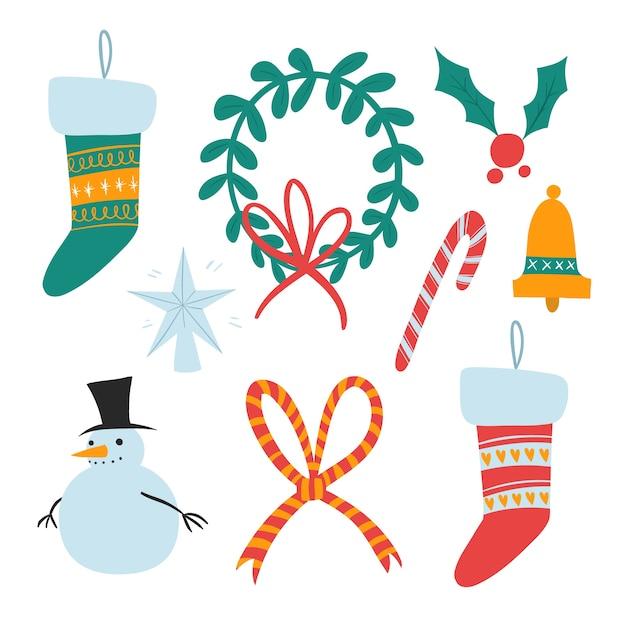 Set di decorazioni natalizie disegnati a mano Vettore gratuito